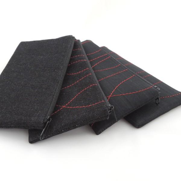 Černé textilní pouzdro na mobilní telefon, ušitéz rifloviny nebo ze softshellu, barevně proštepované ozdobným stehem.
