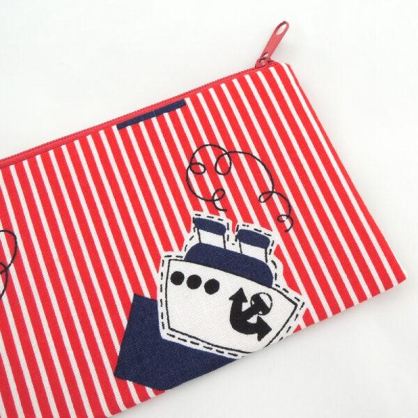 obal na mobil z barevného textilu, zapínání na zip
